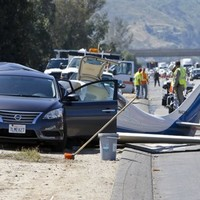 Woman killed after plane crashes into car