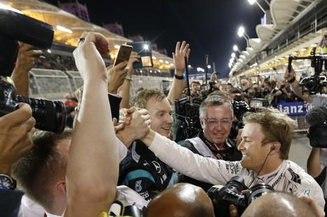 Rosberg celebrates with his Mercedes team.