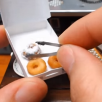 Take a break and watch tiny doughnuts being made in a tiny kitchen