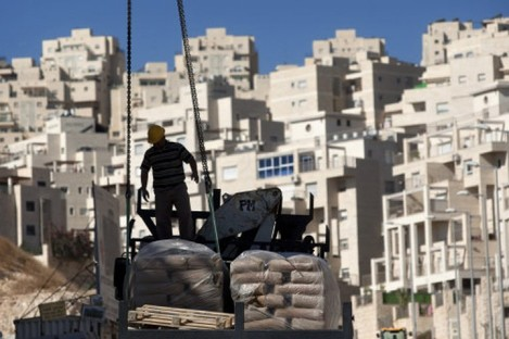 A construction worker working on a new housing unit in east Jerusalem today