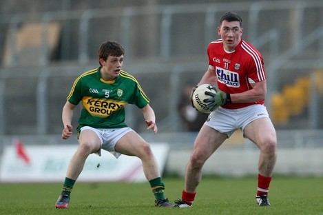 Cork's Sean O'Donoghue with Kerry's Matthew Flaherty in close attendance.