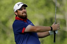 Shane Lowry rediscovers his best form to stay on the tail of early leader Spieth