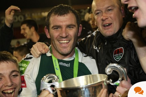 Cork City's Greg O'Halloran and manager Tommy Dunne celebrate with the League of Ireland trophy last Friday night.