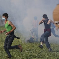 Police fire tear gas at migrants leaving 260+ injured in border clash