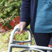 Elderly woman knocked to the ground from zimmer frame by attacker