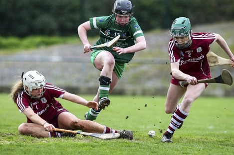 Caoimhe Costello battles Galway's Shauna Burke and Siobhan Coen for possession.
