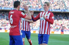 A classy finish from Torres helps Atleti draw level with Barca at the top of La Liga