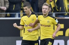 After Euro exit, Dortmund stay in touch with Bayern as 'next big thing' makes history