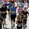 Pics: Boston bombing survivor completes marathon with prosthetic blade