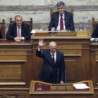 Greek prime minister survives confidence vote