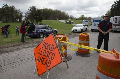 Police block the entrance to one of the shooting scenes in Ohio.