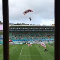 Aussie Rules game delayed after parachutist delivering match ball crash lands
