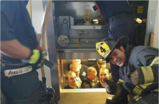 This photo of a fireman rescuing police officers stuck in a lift is pure gold