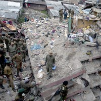 Kenyan rescuers try to reach woman and child trapped in collapsed building