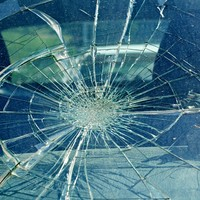 Windscreen of police car smashed with officers inside