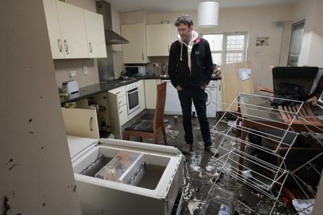 Parnell Road resident David Cahill surveys the damage on 25 October 2011.