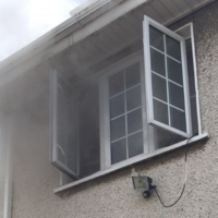 Parent and baby rescued from roof after fire breaks out at Dublin house