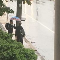 This kid's act of kindness to a little boy getting soaked by rain was just lovely