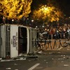 Scandal-hit Penn State chiefs fire legendary coach Joe Paterno as students riot on campus