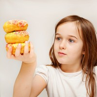 Children at risk of obesity as parents bribe them with sweets and biscuits