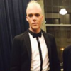 A gay man says he was kicked out of an event at his old school for dressing 'inappropriately'