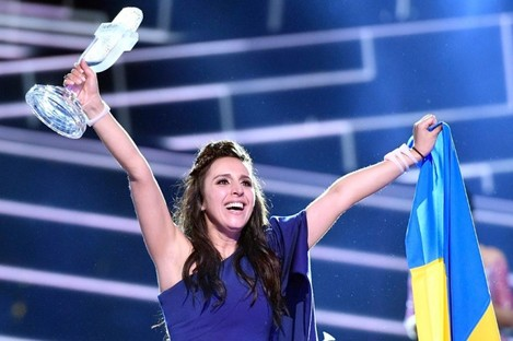 Ukraine's Jamala celebrates with the trophy after winning the Eurovision Song Contest final with the song 1944 in Stockholm, Sweden.