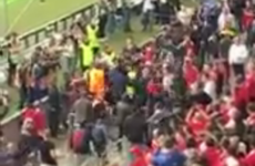 Fighting breaks out in the stands prior to kick-off in the Europa League final