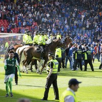 Rangers claim players and staff 'assaulted' by Hibs fans during Hampden pitch invasion