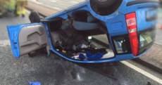 Driver cut out of car after becoming trapped in rollover