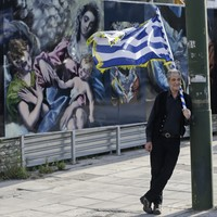 Greece passes spending cuts and tax hikes in order to unlock billions in bailout funds