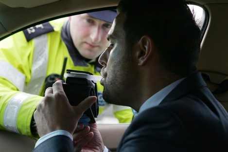 Garda David Maguire and posed model Mark Adams being tested for drink driving in 2011.