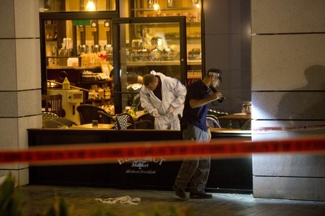 Two Palestinian gunmen opened fire in central Tel Aviv Wednesday night, killing three people and wounding at least five others, Israel police said.