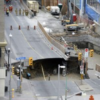 A giant sinkhole has swallowed a van and caused evacuations in Ottawa