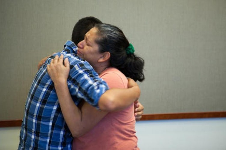 Steve Hernandez hugs his mother after seeing her for the first time in 20 years in San Diego, California.