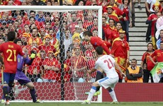 Late Gerard Pique header gets Spain out of jail