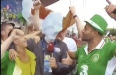 These Irish fans were having serious craic behind a Hungarian TV reporter after the match
