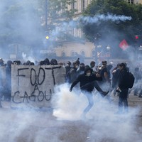 Paris protesters throw missiles at police as demo descends into violence