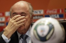 Blatter says sorry for racism comments, refuses to resign