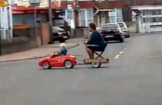 This dad let his toddler give him a lift home on the back of his electronic toy car