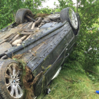 Driver survives serious crash after losing control in heavy rain