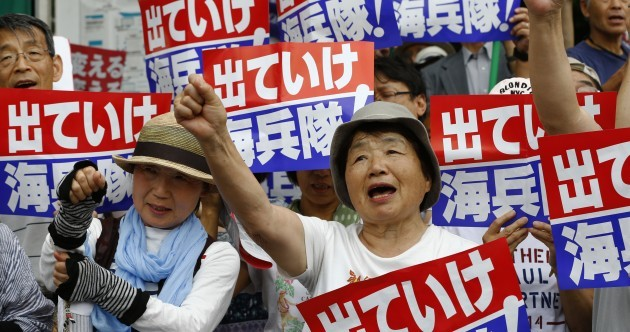 Thousands rally at US military base in Japan after alleged rape and murder of young woman