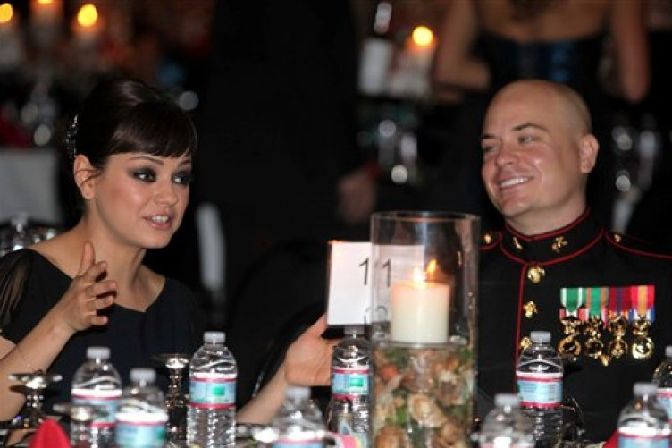 Sgt Scott Moore with his guest, actress Mila Kunis, at the ball on Friday.