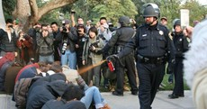 Two officers suspended over pepper-spraying of peaceful protesters