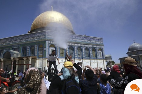 Men spray water on worshippers for the last day of Ramadan