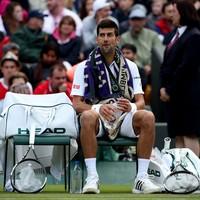 Djokovic saved by rain as Querrey takes two-set lead