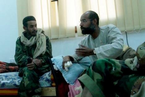Video still of Seif al-Islam Gaddafi, left, after his capture.