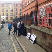 Gardaí arrive as residents protest closure of homeless hostel