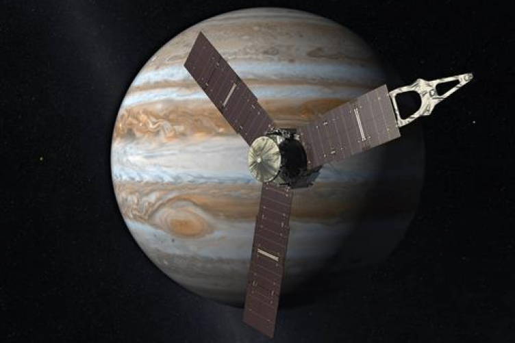 This artist's rendering provided by NASA and JPL-Caltech shows the Juno spacecraft above the planet Jupiter.