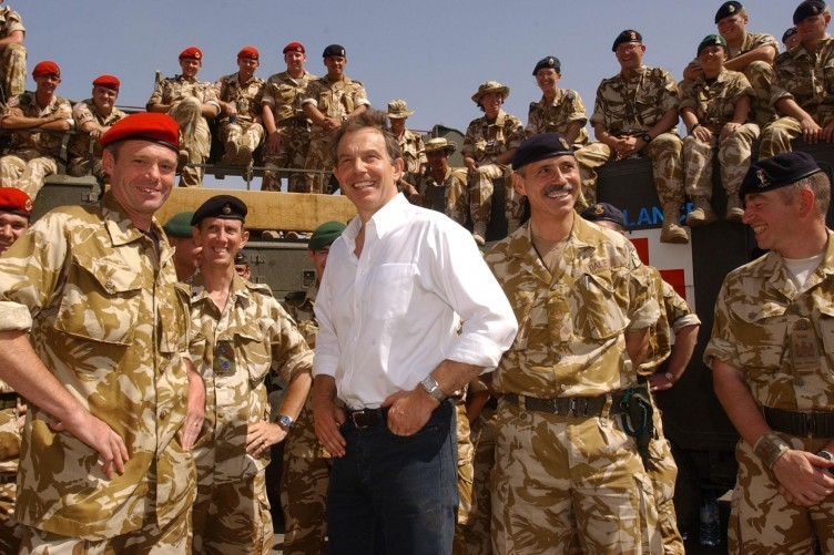 File photo dated 29/05/03 of former Prime Minister Tony Blair meeting troops in the port of Umm Qasr, Iraq.