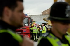 Five men die after wall collapses at recycling site in England